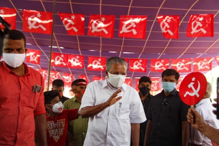 Kerala Chief Minister Pinarayi Vijayan waving hands at an election meeting