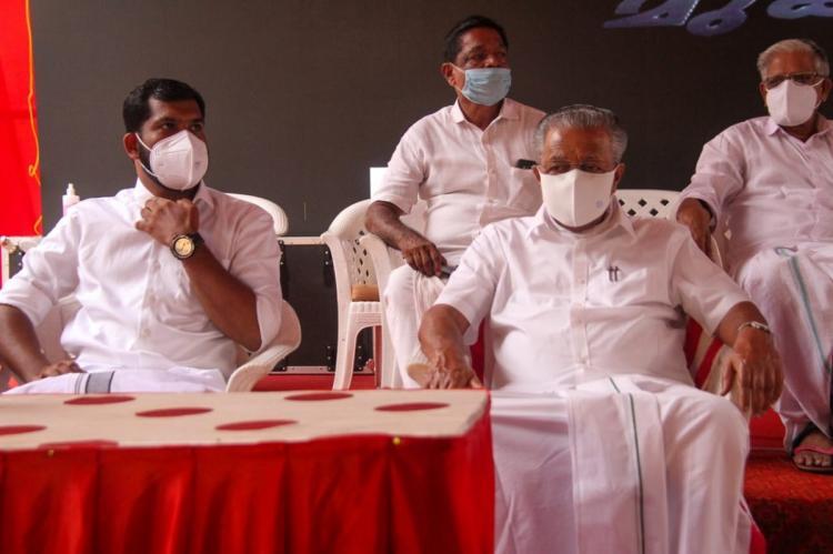 Kerala CM Pinarayi Vijayan sitting at an election campaign meeting wearing mask and maintaining physical distance