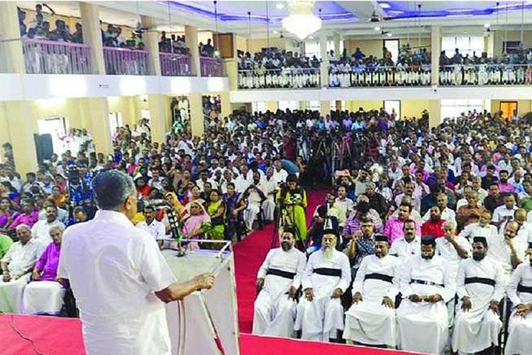 Pic of Christian priests at Pinarayi campaign violates code of conduct Congress to EC