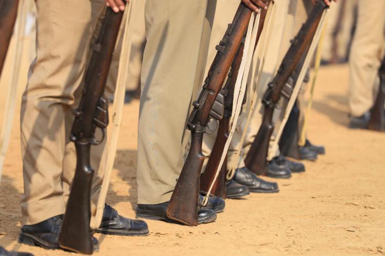 Policemen holding guns