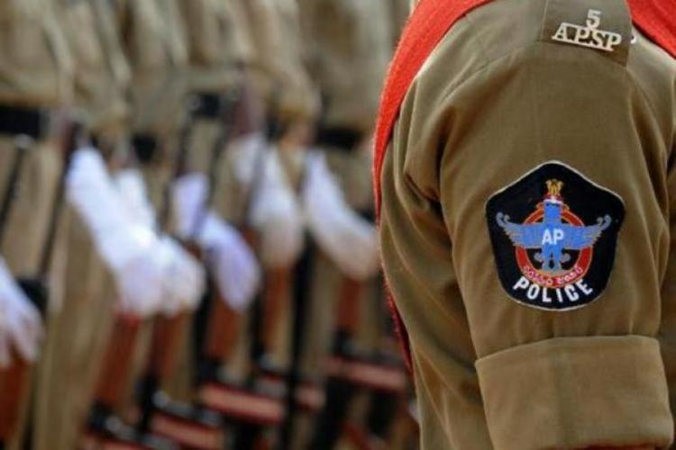 Andhra Pradesh police badge visible on sleeve, a series of policemen are standing in line