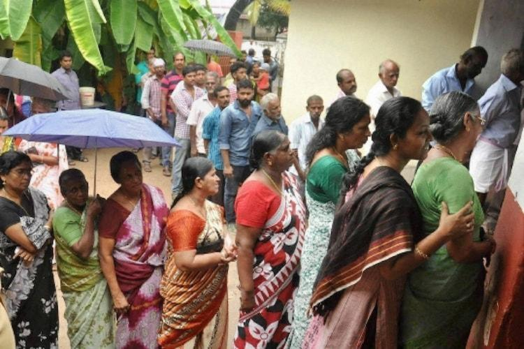 Women waiting at a polling booth in Kerala to caste votes