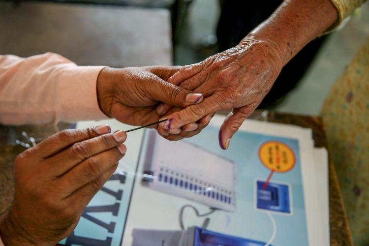 GHMC election results: A voter gets her finger marked with indelible ink at a polling station