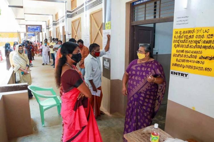 Voters waiting in front of a polling booth in Kerala