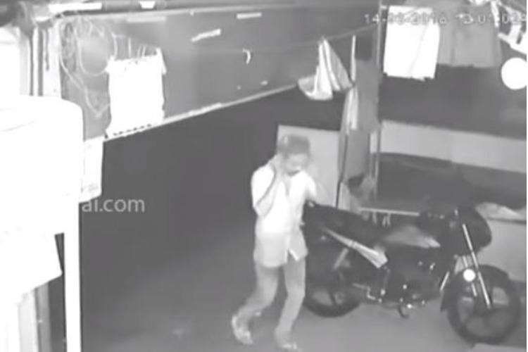 Hilarious robbery caught on cam Thief uses polythene bag to hide face arrested