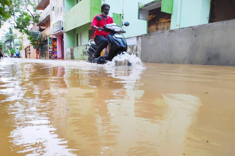 A bike wading through rainwater