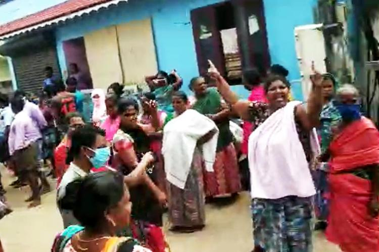 Women out on the street protesting the restrictions in Poonthura during lockdown