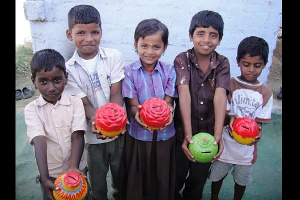 With this piggybank school children save and do their bit for charity