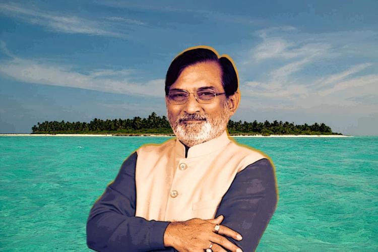 Lakshadweep Adminstrator Praful Patel against the background of Lakshadweep island and a turquoise sea