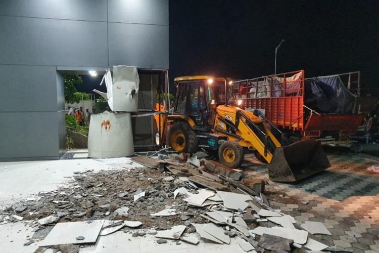 The Praja Vedika in Undavalli being demolished by a JCB