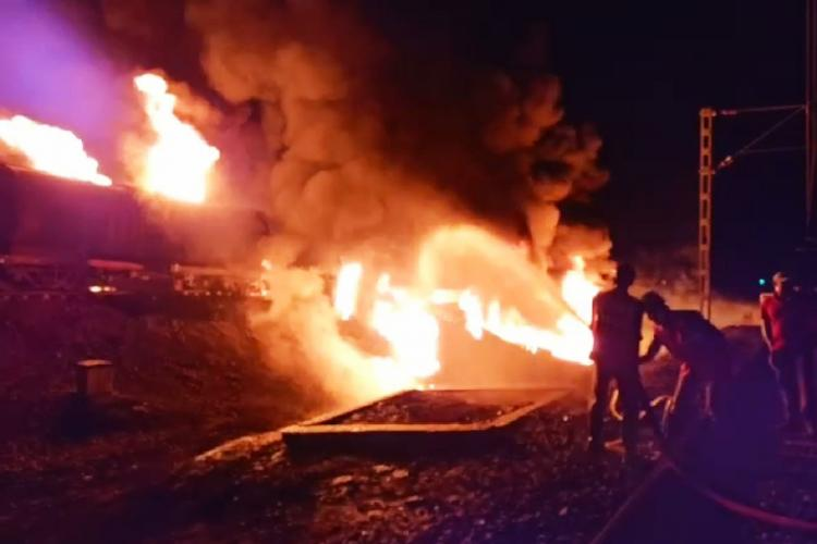 Fire service workers dousing a fuel tanker on fire in Prakasam district in Andhra Pradesh