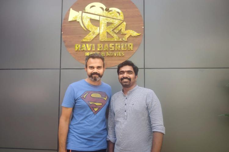 Director Prashant Neel and music composer Ravi Basrur seen together in a photo taken outside Ravi Basrur music studios