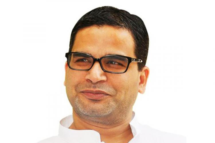 Prashant Kishor looking away from the camera and smiling