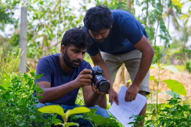 Neelam content lead Prashant Ramasamy with Tamil film director Pa Ranjith looking at a camera in an outdoor location