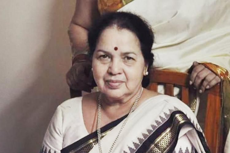 Yesteryear actress Prathima Devi dressed in an off white saree looking into the camera