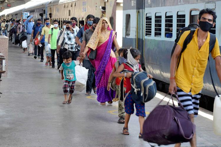 Migrant workers leaving a railway station
