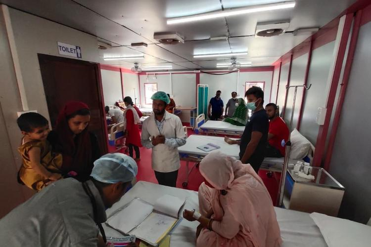 Doctors and other medical staff attend to patients at a cabin-like 100-bed hospital in Bihar set up by startup Modulus Housing and funded by Wells Fargo
