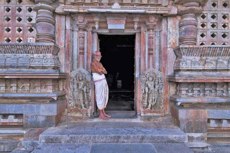 An Indian Hindu Priest Standing at a Temple Door Step