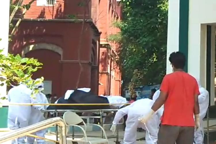 The matrons mortal remains being moved from the hospital
