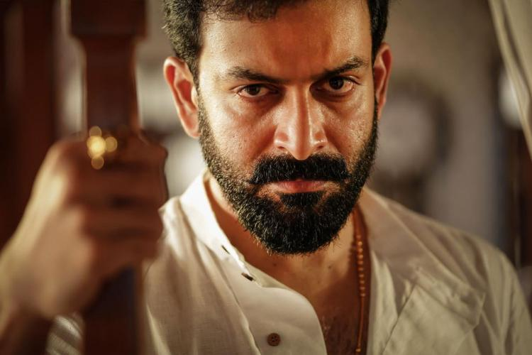Prithviraj is seen donning a white shirt striking an angry look