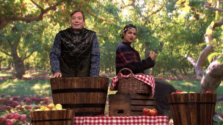 Priyanka Chopra and Jimmy Fallon compete in a game of bobbing apples guess who wins