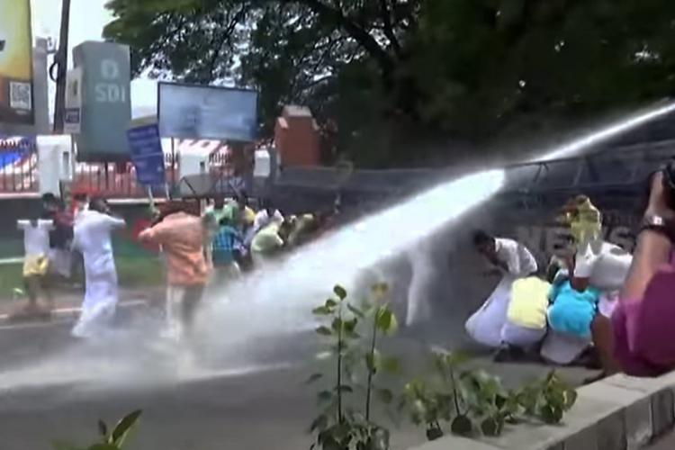 Police Dispersing Water Cannon to Protesters who protested demanding Minister AK Saseendran's resignation
