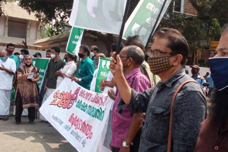 Farmers and activists hold protest in Kerala to express solidarity with the farmers in Delhi They are seen holding placards in Malayalam