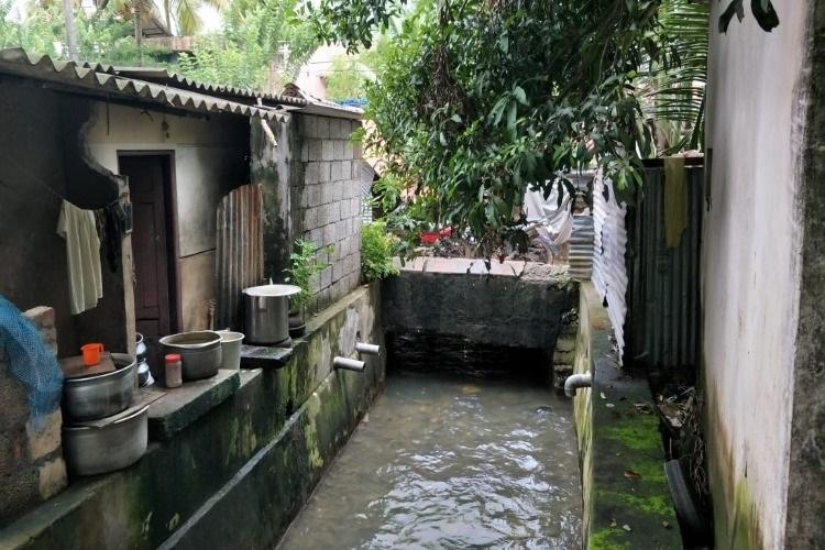 Barely 2 kilometres from Kollam Corporation Office a colony lives with open drains no toilets