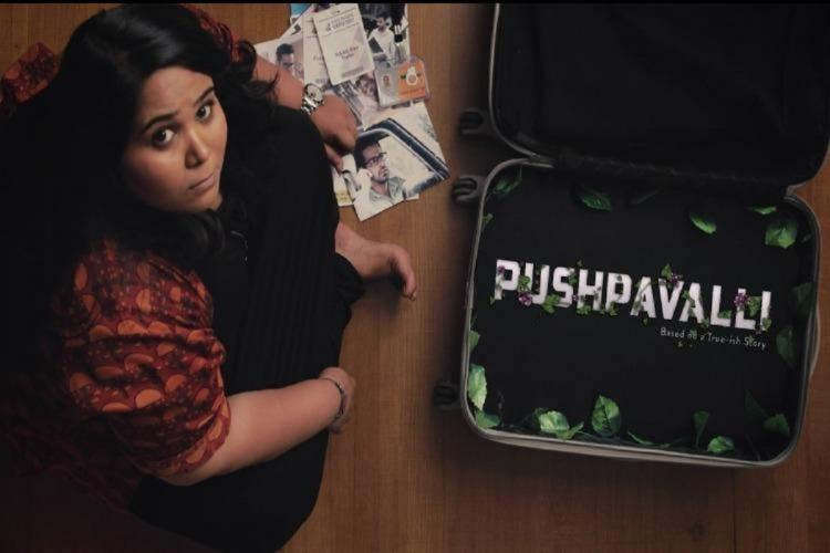 Sumukhi Suresh sitting with a suitcases that says Pushpavalli