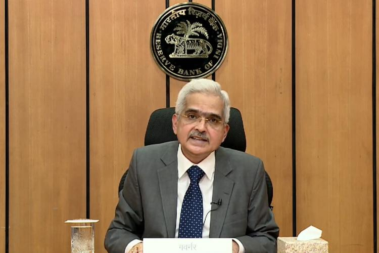 RBI Governor Shaktikanta Das speaking at the Reserve Bank of India with the emblem being seen behind him