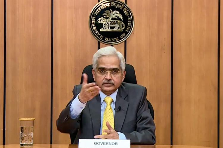 RBI Governor Shaktikanta Das announcement hand raised and pointed at camera