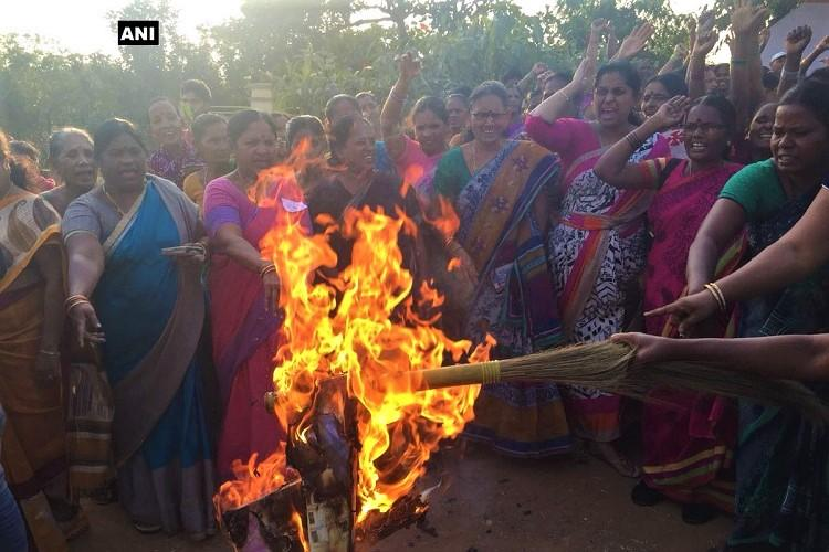 Women protest against RGVs God Sex and Truth in Vizag burn effigy