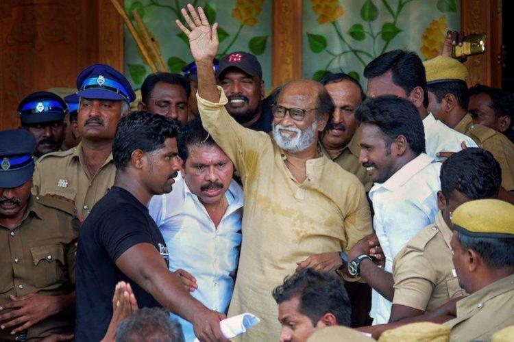 Actor Rajinikanth waving at his fans and Rajini Makkal Mandram members