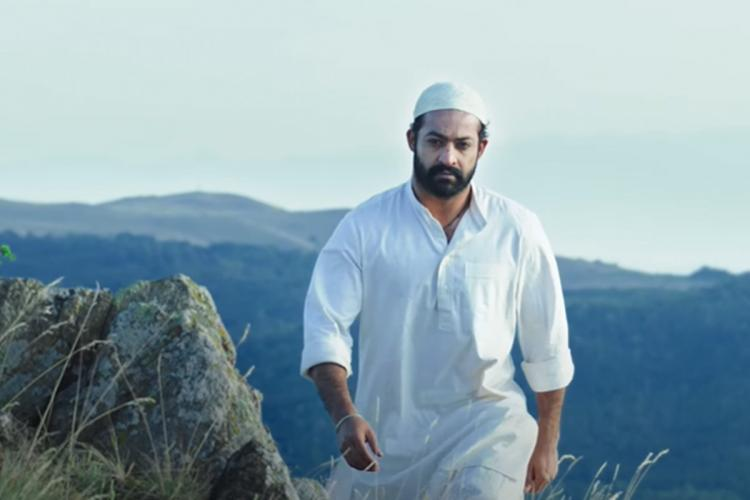 Jr NTR as Komaram Bheem from RRR wearing a Muslim skull cap and a pathani kurta-pyjama