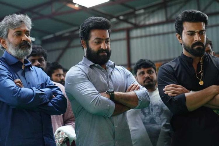 Rajamouli Jr NTR and Ram Charan at RRR shoot with their arms folded and turning slightly to their left
