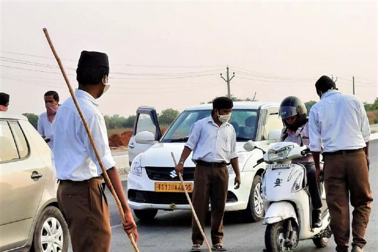 Images of lathi-wielding RSS workers checking vehicles in Telangana ignites row