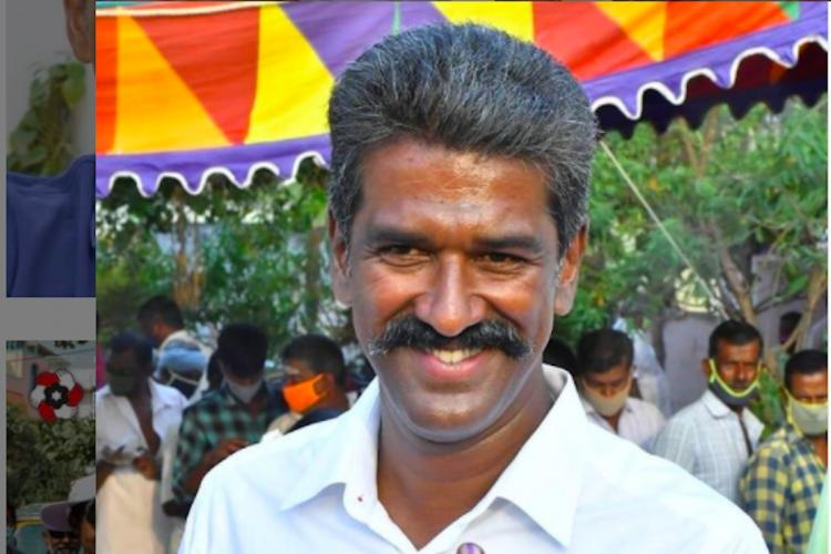 Close up of R Mahendran in a white T shirt