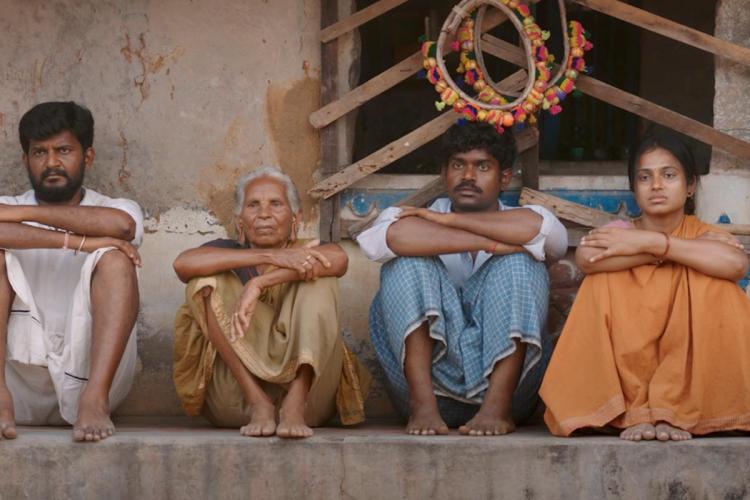 Still from Raame Aandalum Raavane Aandalum showing four characters sitting