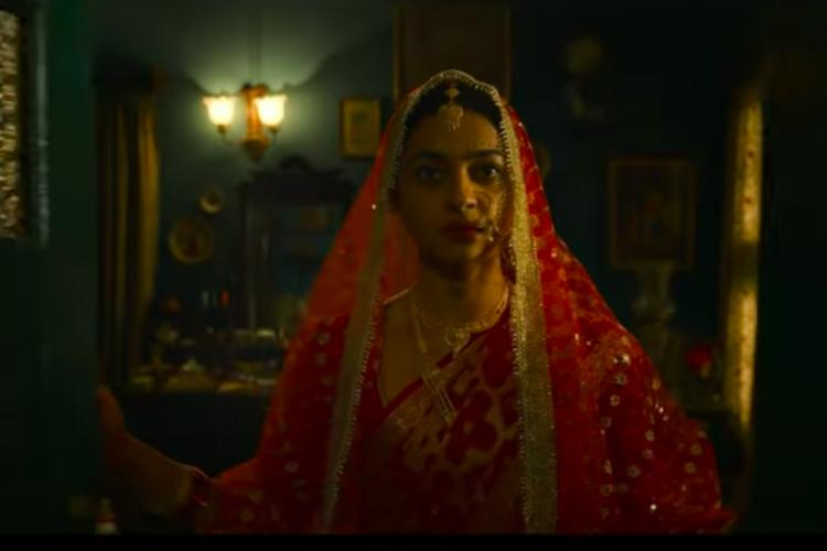 Radhika Apte in bridal wear in the trailer wearing pink and a dupatta around her head