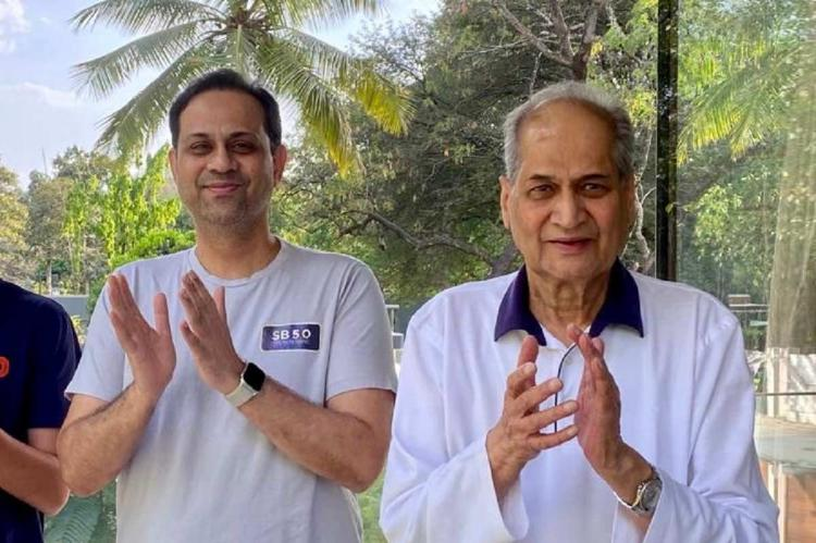 Sanjiv Bajaj and Rahul Bajaj standing al applauding at the end of the one day lockdown on March 22