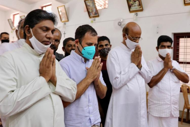 Congress MP Rahul Gandhi praying at a Kerala Church on the day of election flanked by priests during Kerala Assembly election campaign
