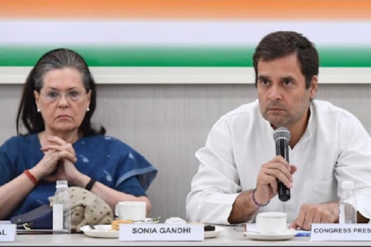Rahul and Sonia addressing a meet