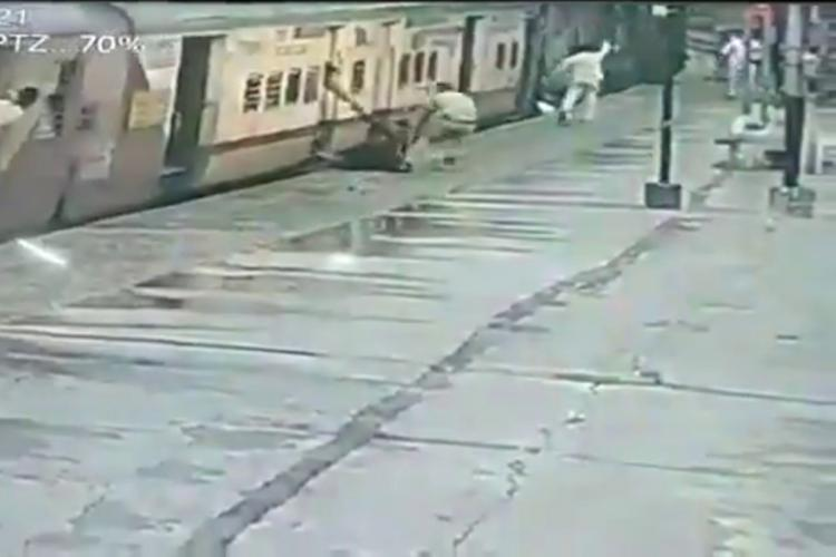 CCTV footage of a woman being rescued by a railway constable