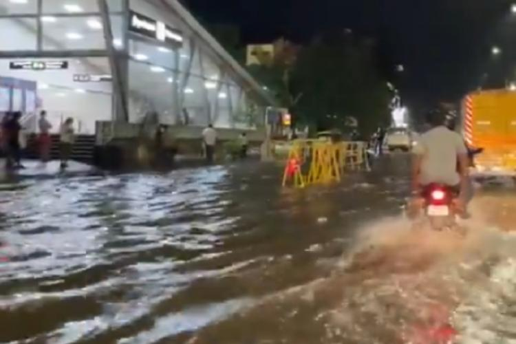 Vehicles driving through an inundated road in Chennai