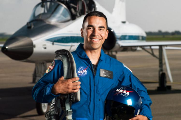 NASA portrait of 2017 Astronaut Candidate Raja Chari in front of a T-38 trainer aircraft at Ellington Field near NASAs Johnson Space Center in Houston Texas