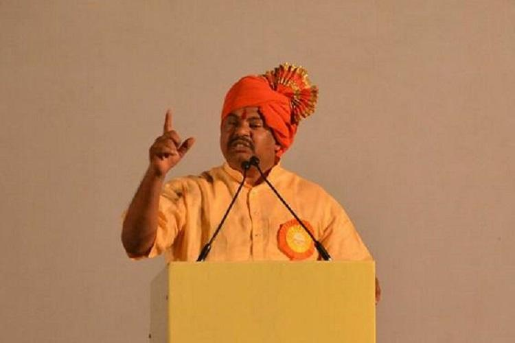 All Hindus must wield weapons BJPs Raja Singh booked for hate speech