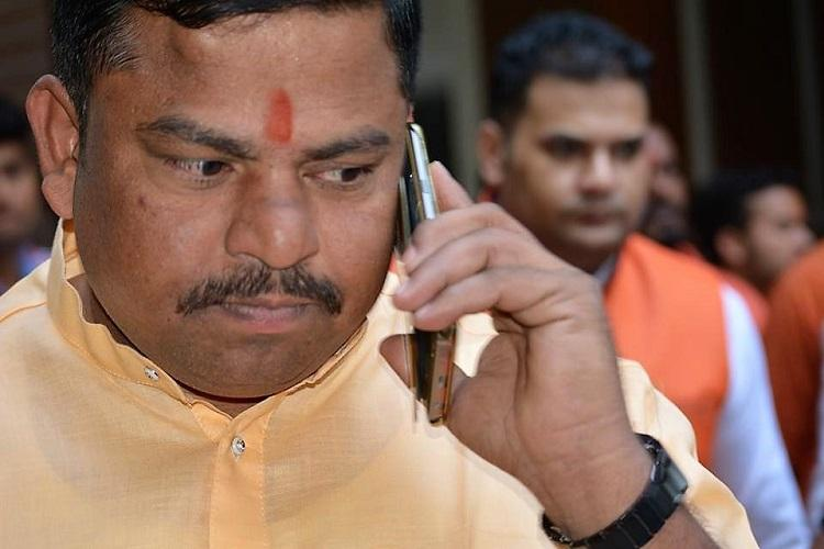 Hyd BJP MLA Raja Singh booked for inciting violence brandishing sword at rally