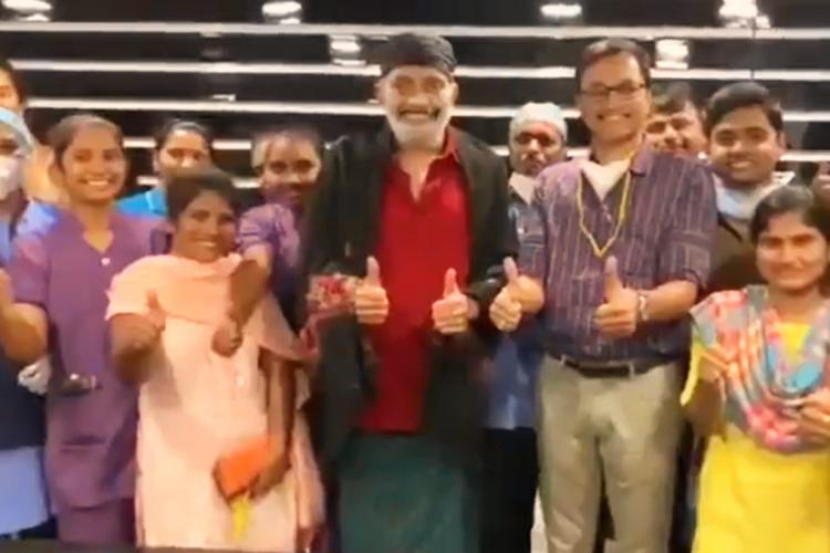 Actor Rajasekhar in red shirt and black shawl can be seen along with the hospital staff from where he was discharged from