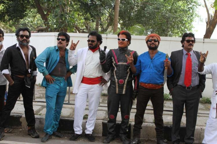 Rajinikanth lookalikes posing in front of his house in Poes Garden in Chennai on his birthday