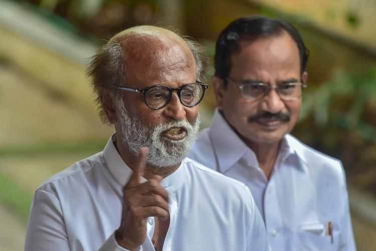 Superstar Rajinikanth with Tamilaruvi Manian during his party announcement in Chennai Poes Garden residence
